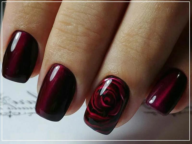 Бордовый маникюр с розами