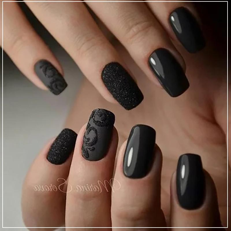 Черный маникюр с объемным узором и черными блестками